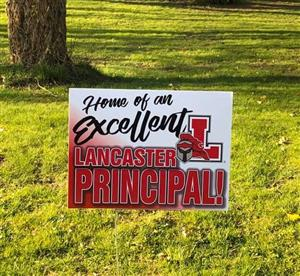 Sign says Home of an excellent Lancaster Principal.