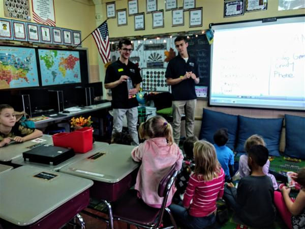 Students provide financial literacy to elementary students.